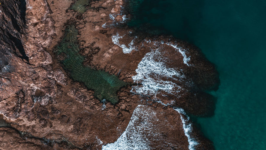 Aerial Photography of waves crashing against rocks. Aerial View Aerial Photography Drone Shot Drone View Seascape Ocean Ocean View Philippines Wallpaper Beach Life Waves Nature Nature Photography Environment Rocky Beach Waterscape Saltwater Waves Crashing Crashing Waves  No People Sea Outdoors