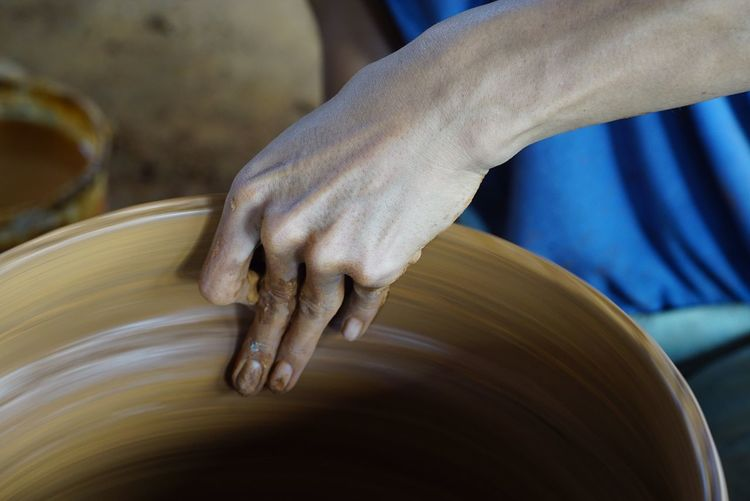 Close-Up Of Hand Making Pot