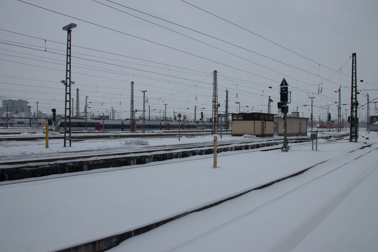 Cold Temperature Snow Winter Rail Transportation Cable Transportation Track Railroad Track Electricity  Public Transportation Train Sky Nature Connection Mode Of Transportation Power Line  Technology Train - Vehicle Electricity Pylon No People Power Supply Outdoors