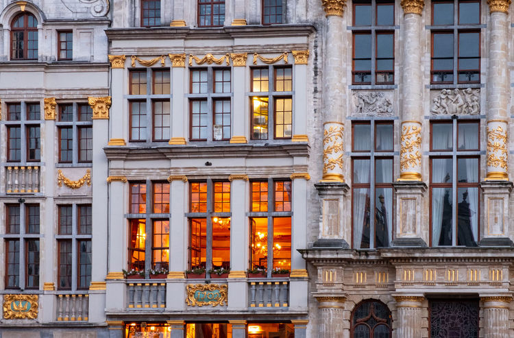Illuminated windows in La Grande Place, Brussels. Brussels The Grand Place Tourist Attraction  Apartment Architectural Column Architectural Feature Architecture Building Building Exterior Built Structure City City Life Full Frame Government History Illuminated La Grand Place Luxury No People Ornate Outdoors Travel Destinations Window Windows Of My World Windows_aroundtheworld