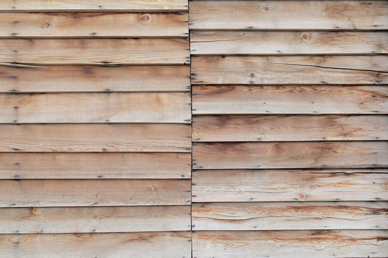 two segments of overlaid planks material Planks Wooden Wood Material Parallel Segments Texture Background Pattern Wallpaper Brown Overlaid Paint Polish Lacquer Nails Carpenter Nature Aged Floor Striped Surface Board Building Pine Timber Design Row Hardwood Structure Fence Panel Boarding House Wall Rough Home Construction Vintage Grunge Oak Textured  Weathered Lumber Old Cracked Woodwork  Siding Natural Abstract