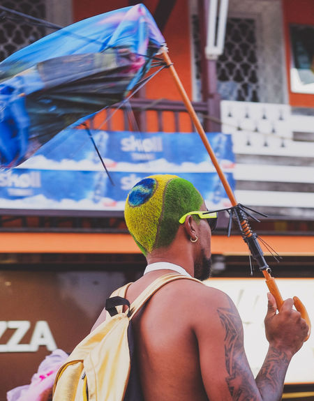Martinique Carnival - Brasil Hair Brasil Caribbean Carnival Colors Of Carnival Fun Islandlife Lifestyles Martinique Men Parade Real People Rear View Stand Up Streetphotography Sunglasses Tattoo Umbrela