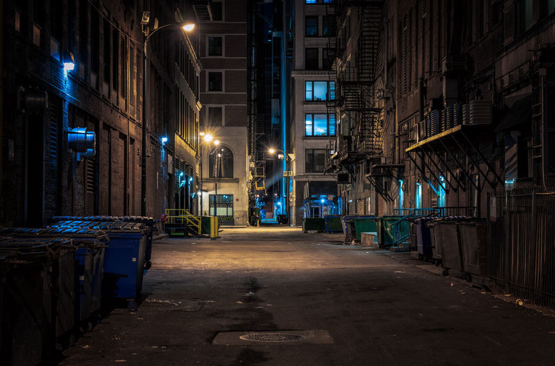 Chicago downtown alley at night Full Frame Architecture Building Exterior Built Structure Illuminated Night City Building The Way Forward Street No People Street Light Lighting Equipment Diminishing Perspective Empty Abandoned Chicago Illinois Moody Sky Gritty Dark Urban Alley Downtown Trash Can Waste Container Empty Road Urban Scene Skyscraper Tall - High