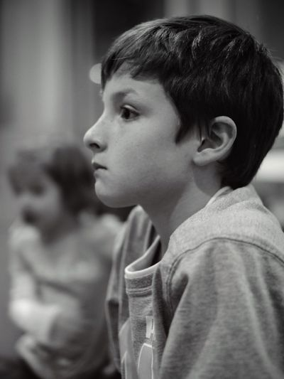 Close-up of boy looking away