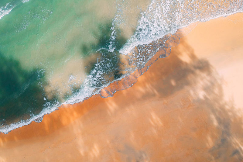 Water Motion No People Nature Beauty In Nature Wave Close-up Outdoors Day High Angle View Land Sea Orange Color Scenics - Nature Environment Full Frame Landscape Power In Nature