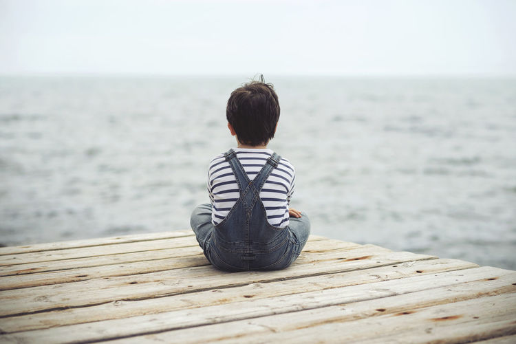 Dream Freedom Holidays Innocence Love Beach Boy Child Childhood Expression Horizon Over Water Nostalgic  Ocean Outdoors Outdoors❤ Portrait Rear View Sad Sadness Sea Sitting Summer Thoughtful Water