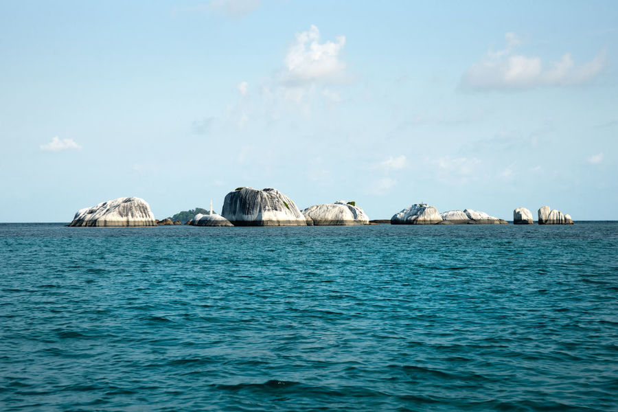 Natural rock formation at sea in Belitung Island in the afternoon, Indonesia. Banka Beach Belitung Belitung Indonesia Belitung Island Coastline Landscape Daytime Granite Formations Granite Rocks Ocean Pristine Rocks And Water Rocks On The Shore Seaside Stones Sumatra  Summer Tanjung Tinggi Tranquil Scene Tranquility Travel Destinations Tropical Climate Vacation Destination White Sand Beach