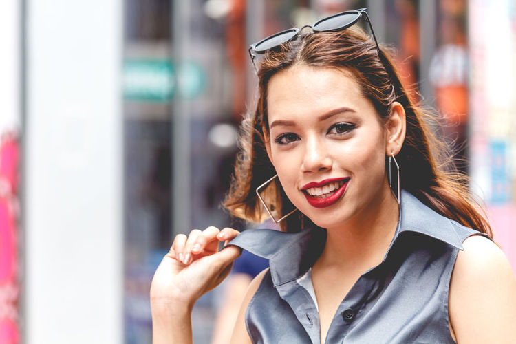 Close-up portrait of happy young woman in city