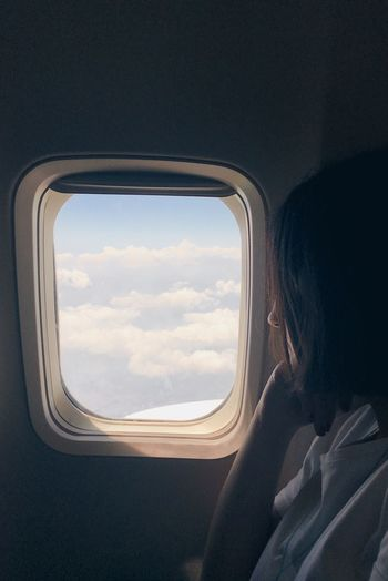 Travelling Travel Summer Window Vehicle Interior Mode Of Transportation Transportation One Person Sky Travel Airplane Cloud - Sky Lifestyles Journey Air Vehicle The Traveler - 2018 EyeEm Awards Flying Side View Looking At View Women A New Beginning Capture Tomorrow It's About The Journey