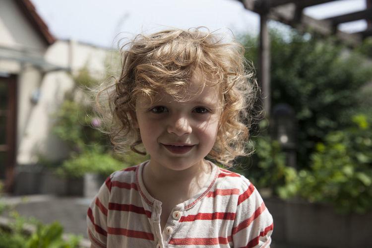 Portrait of cute smiling girl in lawn