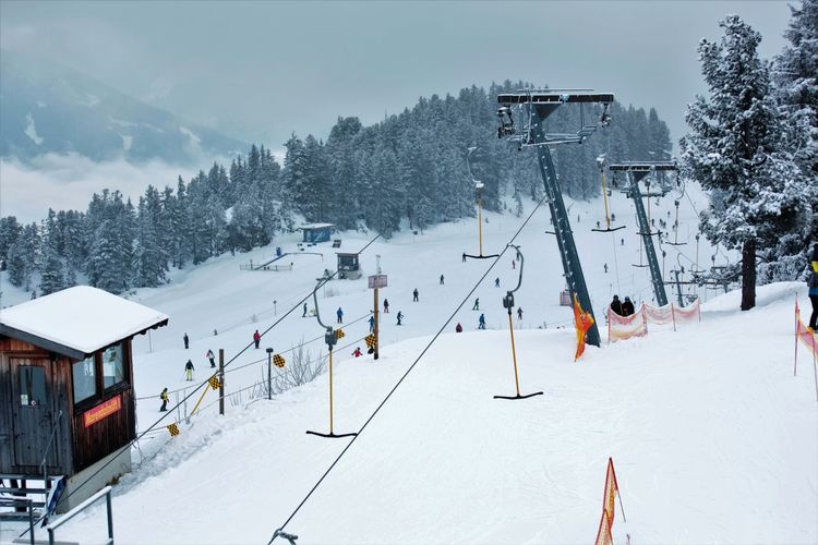 Ski Lift Cold Temperature Mountain Skiing Snow Snowcapped Mountain Sport Tree Vacations White Color Winter Winter Sport