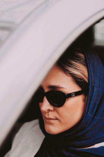 Portrait of mature woman wearing sunglasses