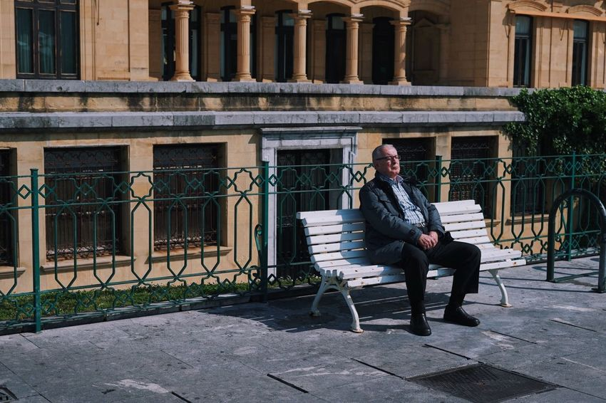 Day 56 Sitting One Person Architecture Full Length Real People Lifestyles Bench Building Exterior Built Structure Leisure Activity Seat Casual Clothing Building Adult Day Relaxation Men Nature