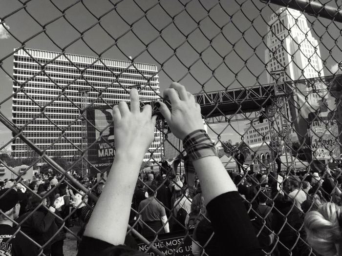 """""""Don't give up"""" compliments of Sia https://youtu.be/GKSRyLdjsPA Womens March 2017 Real People Women Fence Shootermag Movment Black And White From My Point Of View Streetphotography A Week On Eyeem Eyeem Collections EyeEmBestPics Love And Peace Hold On Hands Togetherness Photo Journalism Hope Pouplar Photos For Friends That Connect  Art Photography Inspirational Moment"""