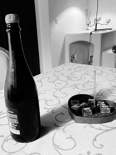 Close-up of wine bottle on table at home