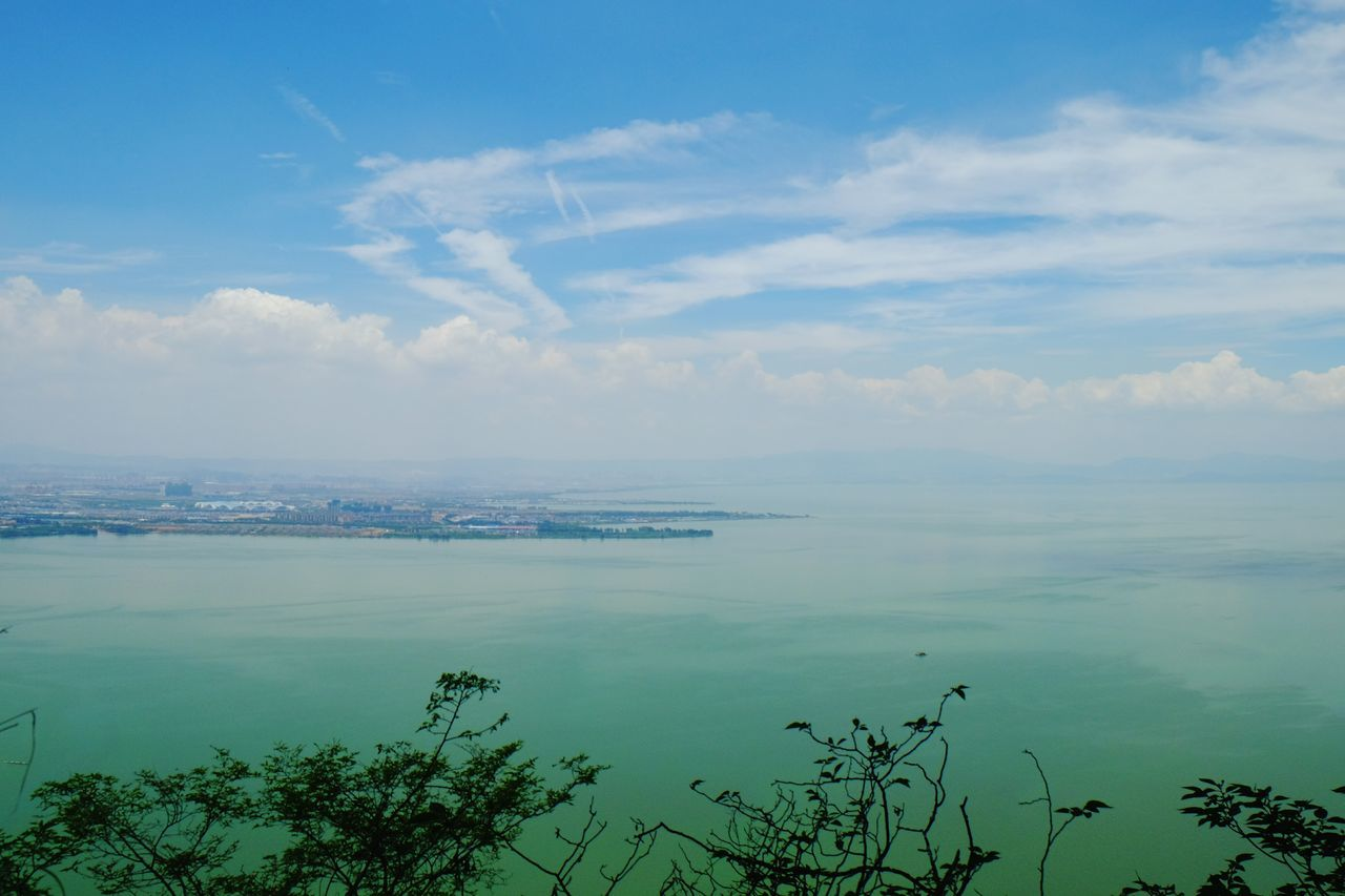 sky, water, sea, cloud - sky, beauty in nature, nature, no people, outdoors, tranquility, scenics, tranquil scene, day, horizon over water, cityscape, city