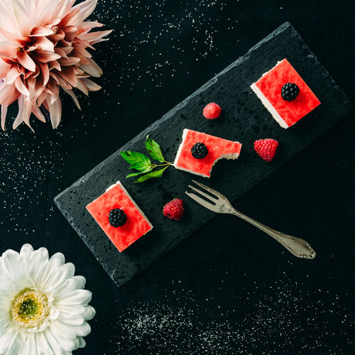 Flowering Plant Flower Freshness Plant High Angle View Nature Food And Drink Food Fruit Leaf Black Background Food And Drink Dessert Serving Size Serving Dish Plate Of Food Berries Berry Fruit Raspberry Raspberries