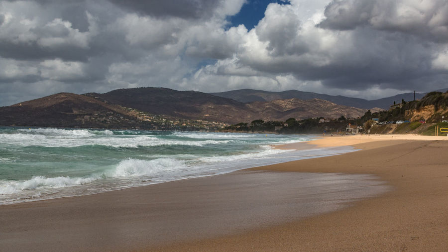 view over beach in sagone corsica 16:9 Corsica ❤️ Beach Beach Sagone Beauty In Nature Cloud - Sky Day Esigna Mountain Nature No People Outdoors Sagone Sand Scenics Sea Sky Tranquil Scene Tranquility Water Wave