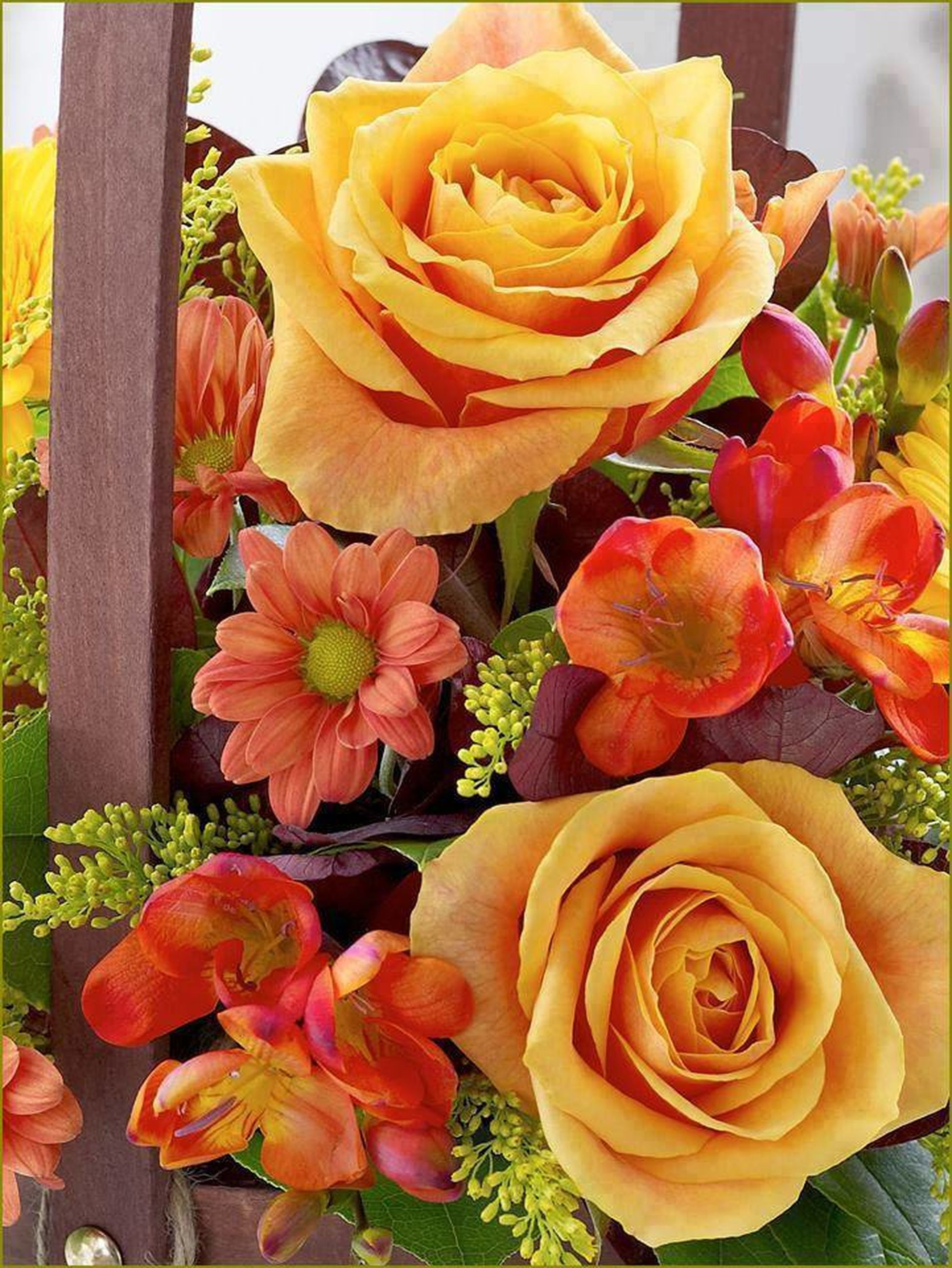 flower, freshness, rose - flower, petal, flower head, fragility, indoors, rose, beauty in nature, close-up, bouquet, yellow, blooming, vase, nature, flower arrangement, growth, multi colored, plant, no people