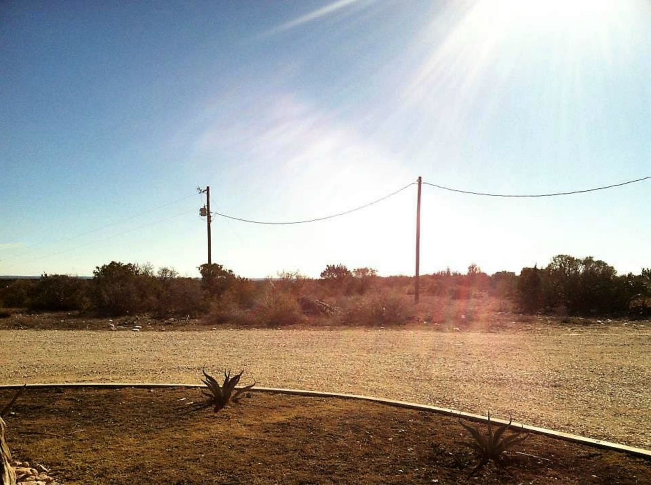 sunlight, day, no people, sky, outdoors, nature, field, tree, electricity, beauty in nature, growth