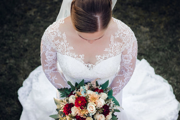 bride holding wedding boquet of flowers high angle view Flower Flowering Plant White Color Women Real People Wedding Dress Event Flower Arrangement Plant One Person Bouquet Celebration Adult Newlywed Bride Lifestyles Front View Wedding Midsection Nature Flower Head Wedding Boquet