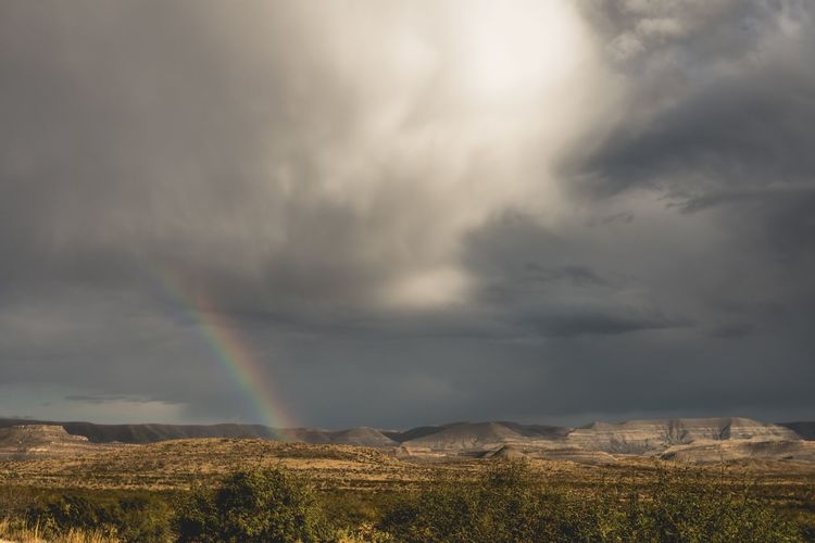 Rainbow in the Desert Rainbow Landscape Cloud - Sky Weather Tranquility Scenics Nature Beauty In Nature Desert No People Outdoors Desert Landscape Deserts Around The World Desert Sky EyeEmNewHere Stormy Weather The Great Outdoors - 2017 EyeEm Awards The Great Outdoors - 2017 EyeEm Awards