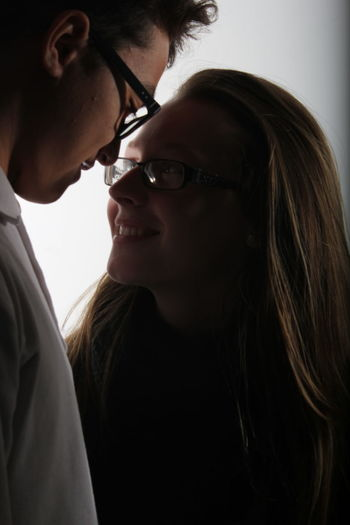 Close-Up Of Couple Romancing At Home