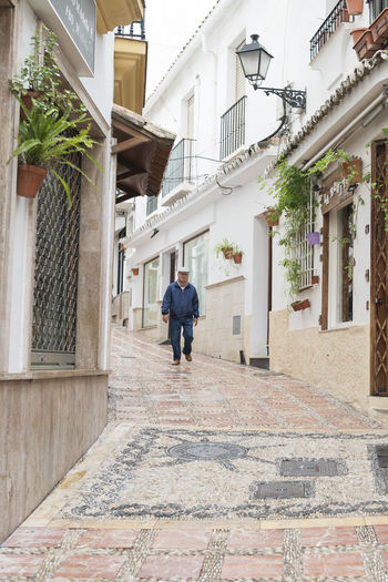 Marbella MarbellaOldTown Old Town SPAIN Architecture Spanish Architecture Holiday Destination Vibrant Color Built Structure Building Exterior Building Real People Men One Person Lifestyles Day Walking Leisure Activity House Residential District Full Length City Adult Outdoors Alley