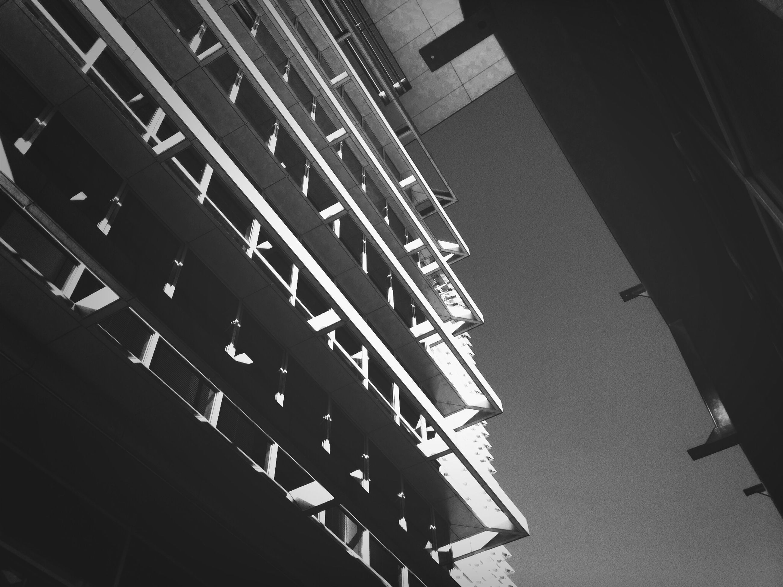 building exterior, architecture, built structure, low angle view, residential building, city, building, residential structure, window, apartment, clear sky, outdoors, balcony, in a row, no people, day, sky, house, city life, tall - high