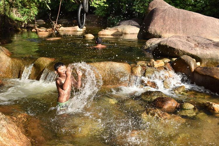 Full length portrait of a woman splashing water