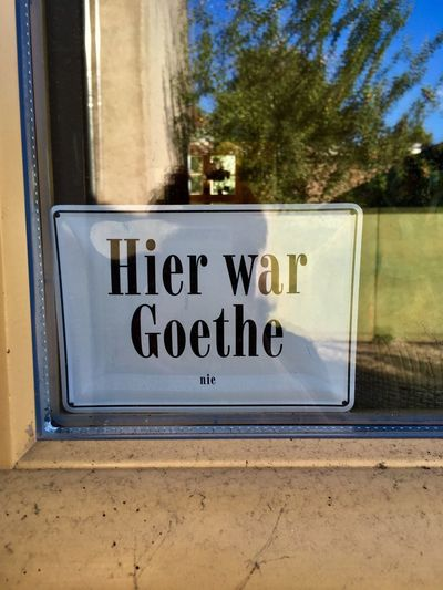 Goethe Words Print Outdoors Detail Art Outdoors Funny Text Western Script Communication Sign Information Day Information Sign No People Glass - Material Outdoors Window Script Capital Letter Warning Sign