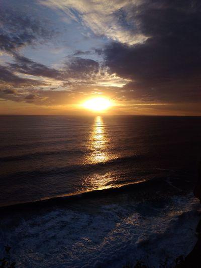 Sunset Uluwatu Shillouette Rumahalir DELTA API Small Island Uluwatu Bali Bali, Indonesia Water Wave Low Tide Sea Sunset Beach Horizon Sunlight Sand Sun