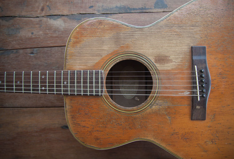 High angle view of guitar on wooden table