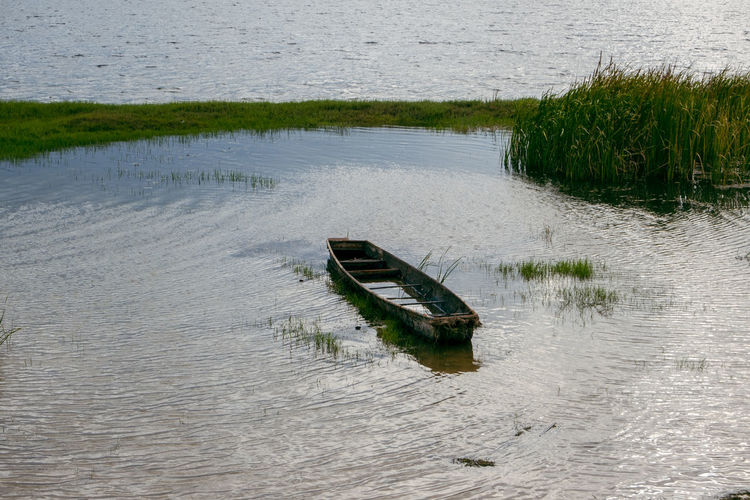 Abandoned boat in river