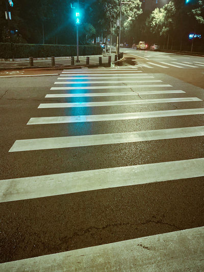 Zebra crossing on road at night