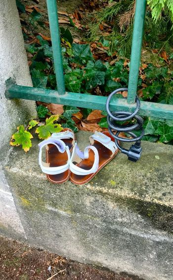 Qui manque sur l'image ?! Shoes High Angle View Day No People Nature Plant Shoe Land Green Color Metal Footpath