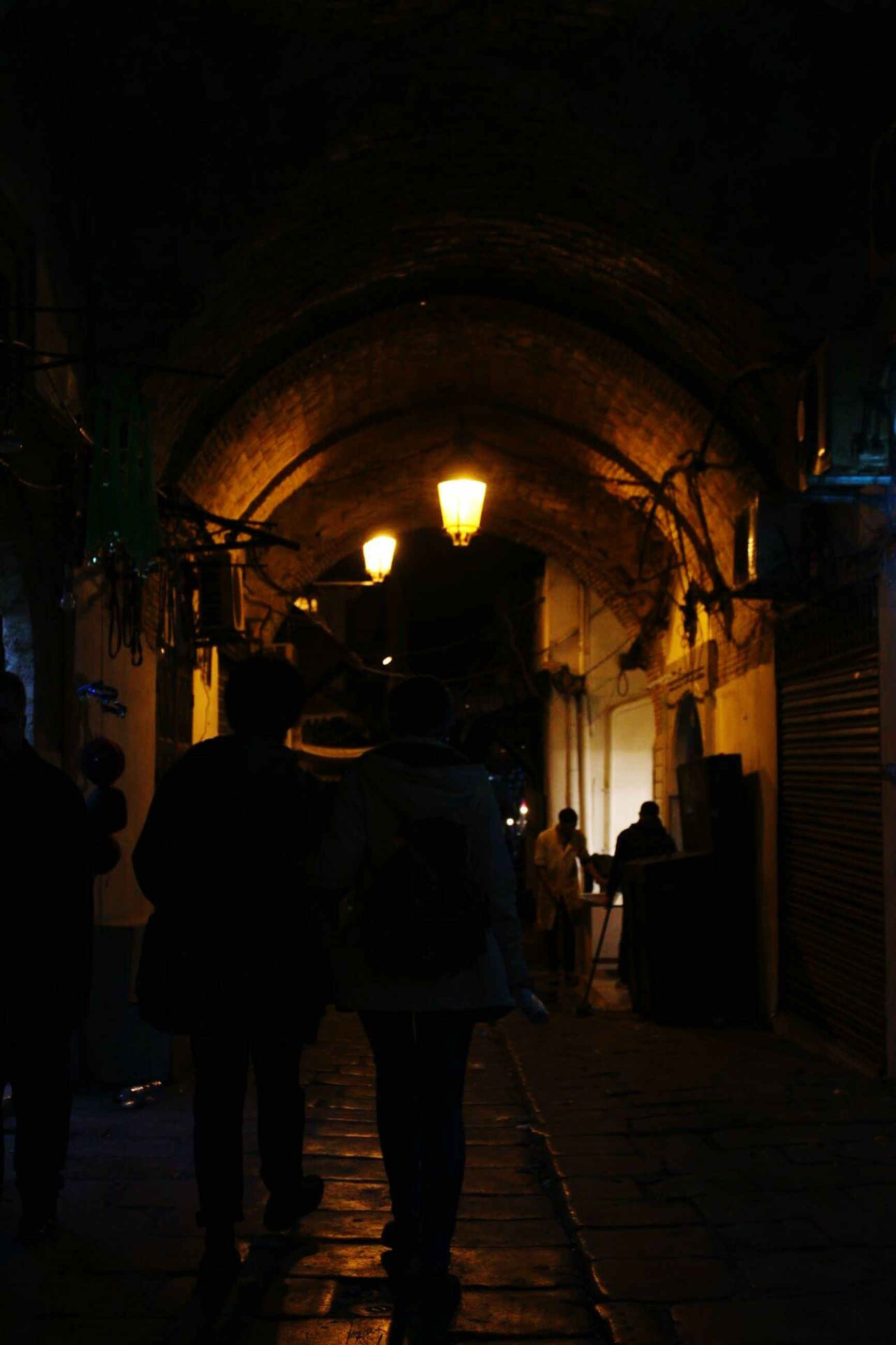 illuminated, walking, night, architecture, built structure, men, city, people, outdoors, adult, adults only