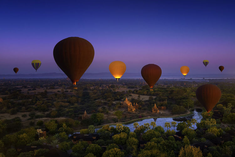 Sunset many hot air balloon with stupas in bagan, myanmar. bagan is an ancient with many pagoda.