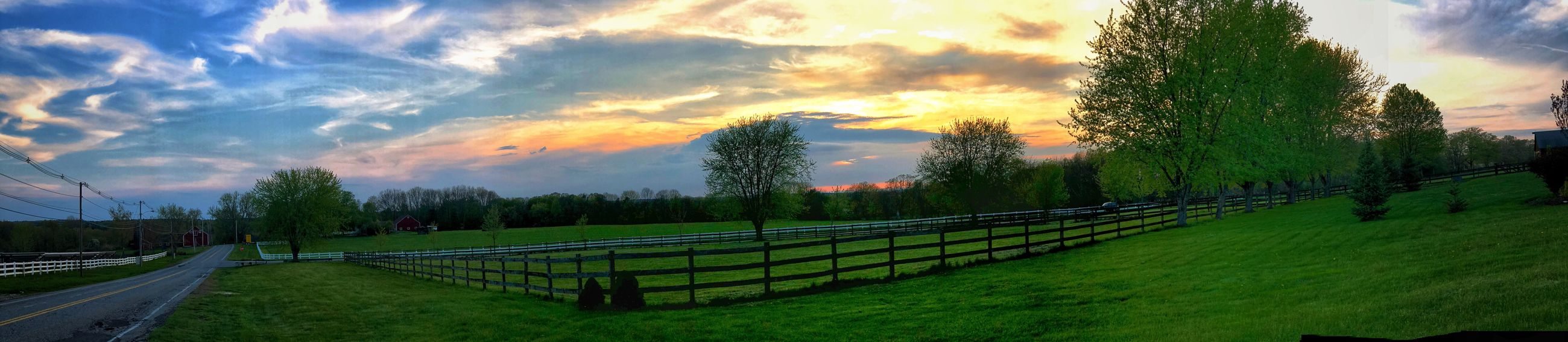 Panoramic View of a Sunset in Farm Country Plant Cloud - Sky Sky Tree Green Color Nature Beauty In Nature Barrier Sunset No People Field Growth Fence Boundary Tranquility Land Tranquil Scene