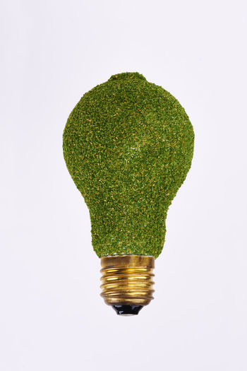 Energy efficient lightbulb on white background Light Bulb Cut Out White Background Energy Efficient Lightbulb Energy Efficient Efficiency Economy Eco Ecology Renewables Alternative Energy Electricity  Energy Symbol Electrical Equipment Lighting Equipment Electronics Industry Business LED Light Halogen Light Concept Environmental Conservation Environment Care Protection Studio Shot Green Copy Space Green Color