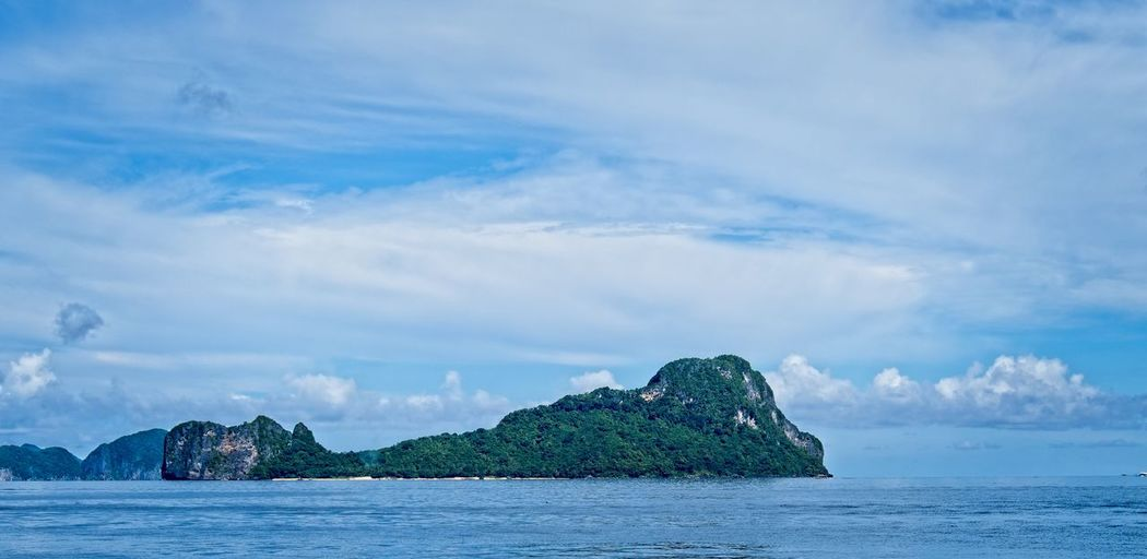 Palawan Philippines Sky Cloud - Sky Sea Water Beauty In Nature Scenics - Nature Tranquility Tranquil Scene Waterfront Day Nature No People Idyllic Rock Blue Land Outdoors Mountain Rock Formation Stack Rock Palawan Philippines Ocean Resort