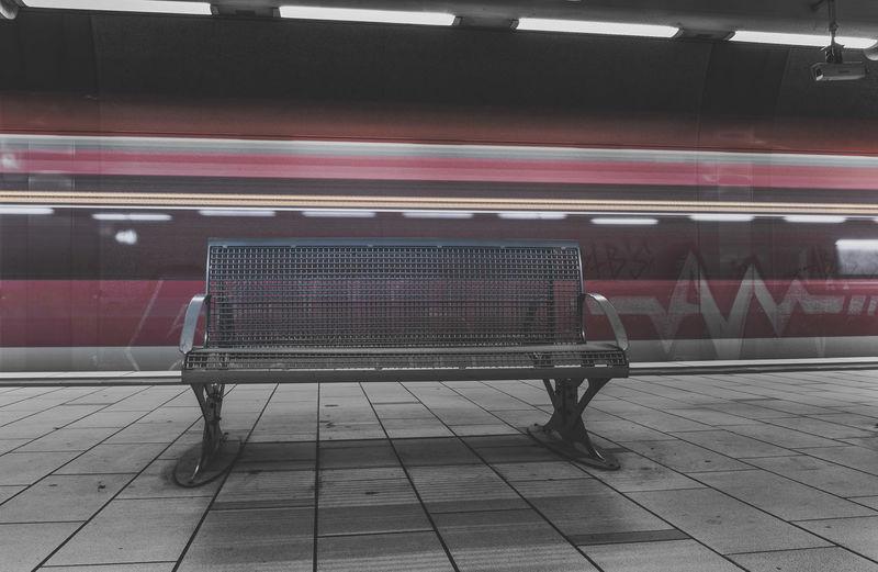 Empty bench on railroad station platform