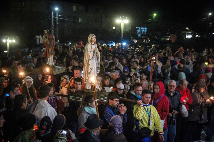 Catholic Catholic Holiday Devotion The Faithful Adult Audience Celebration Crowd Enjoyment Illuminated Large Group Of People Leisure Activity Lifestyles Men Night Nightlife Outdoors People Prayer Real People Reportage Statue Of Our Lady Togetherness Watching Women