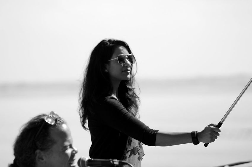 Black & White Black And White Day Exceptional Photographs From My Point Of View Girl Long Hair Men Outdoors People People Photography Person Posing Posing For The Camera Selfie Stick Singing Sky Smiling Sunglasses Taking Photos Of People Taking Photos Taking Pictures Taking Selfies Uniqueness Waist Up Woman