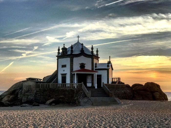 Sunset Architecture Sky Cloud - Sky Built Structure Building Exterior History No People Nature Outdoors Travel Destinations Spirituality Sea Beach Beauty In Nature Scenics Day Water Beauty In Nature Senhor Da Pedra MYheart Tranquil Scene Portugal Atlanric Ocean Architecture