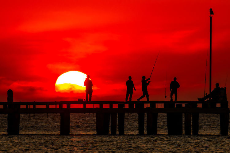Sunset Fishers Sunset Sky Silhouette Water Orange Color Group Of People Real People Beauty In Nature Men Nature Scenics - Nature Sea Cloud - Sky Leisure Activity Fishing Pier People Standing Lifestyles Horizon Over Water Sun Outdoors