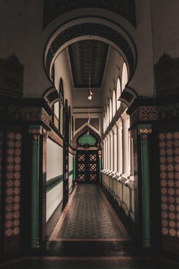 Illuminated corridor of building