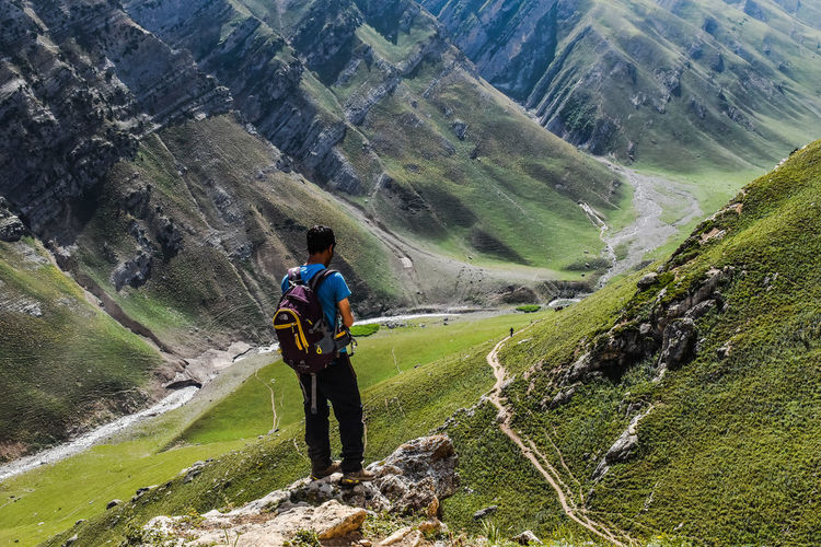 Wait Mountain Full Length Lifestyles Leisure Activity Rear View Landscape Tranquil Scene Scenics Casual Clothing Beauty In Nature Nature Tranquility Tourist Mountain Range Non-urban Scene Adventure Vacations Tourism Remote The Way Forward