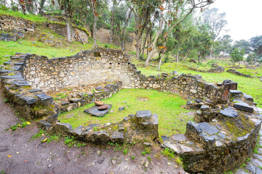 Circular ruins of a house in the ancient ruins of Kuelap, Peru Amazonas Ancient Archeology Architecture Building Chachapoyas Chachapoyya City Culture Fortress Green Kuelap Old Ruin Ruins South America Stone Tourism Travel Travel Destinations Utcubamba