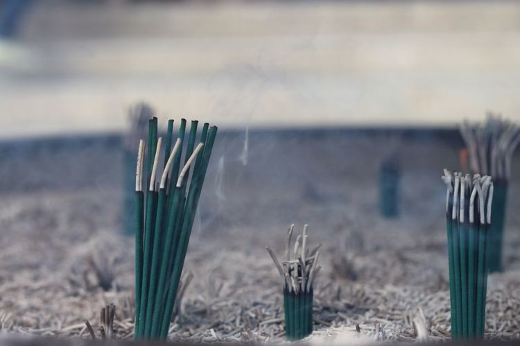 Smoke swirling out from incense sticks